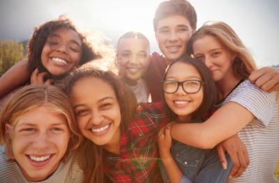 A group of teen friends smiling